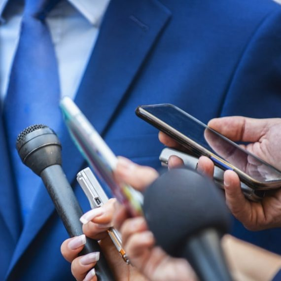 media-interview-journalists-interviewing-politicia-JGRMHSC